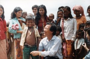 Dr. Haing S. Ngor provides humanitiarian aid in Cambodia. Photo by Jack Ong, courtesy The Dr. Haing S. Ngor Archive.