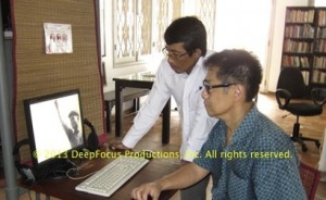 Archivist Sopheap Chea (l) assists Arthur Dong at the Bophana Audiovisual Resource Center, Phnom Penh. © 2013 DeepFocus Productions, Inc.